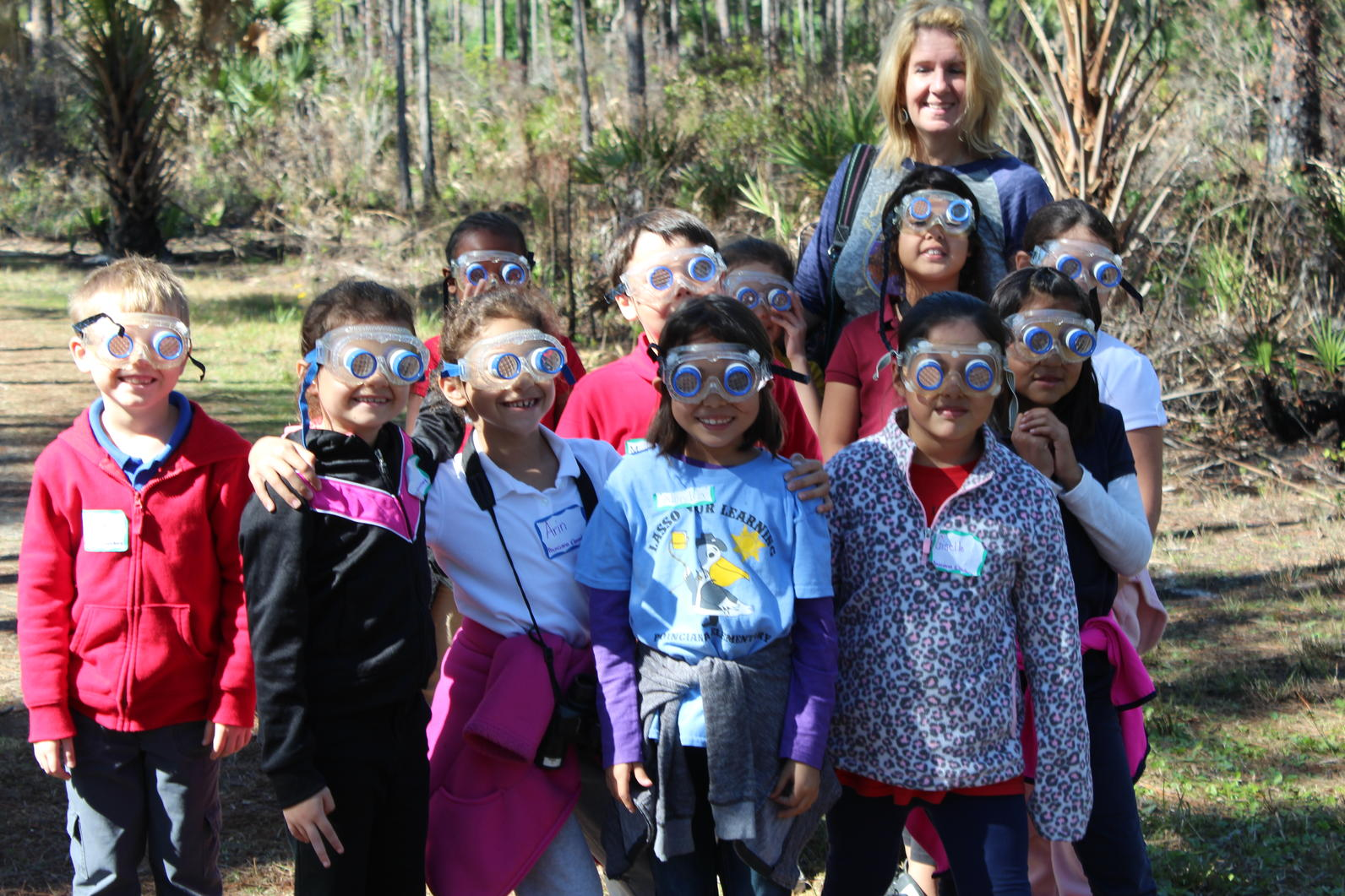 pes students with eye goggles